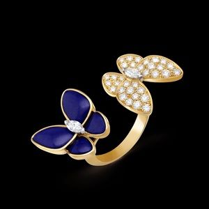 Two Butterflies between the fingers ring.